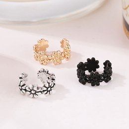 Hollow flower cuff online shopping - New Fashion Style Hollow Metallic Flower Linked Champagne Golden Silver Crystal Ear Cuff Fashion Women Clip Earrings Gifts