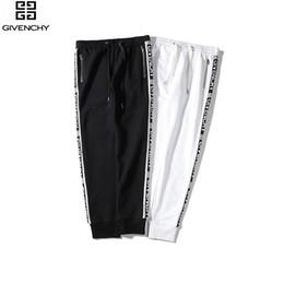 Ingrosso 88261 pantaloni due colori # autunno e l'inverno nuova cerniera personalizzato sezione del nastro in bianco e nero M-XXL.