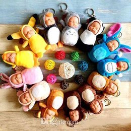 Venta al por mayor de Lindos lindos juguetes de peluche con llavero Sleeping Baby Doll Anillos de cadena para las mujeres Accesorios de la bolsa Llavero de coche Pompom muñecas para niños juguete