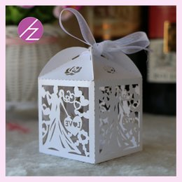 Discount fancy boxes wholesale - 50PCS  lot Hollow Laser Cut Favor Candy Ribbon Boxes Lace With Ribbon Bride And Groom Marriage Ceremony Fancy Dress Part