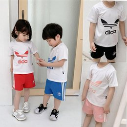 Pearl flower suit online shopping - Kids Designer Clothes Boys Girls AD Letter T shirt Shorts Piece Suit Brand Tracksuit Sports Short Sleeve Sportswear SHORT Set C52501