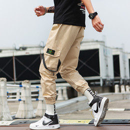 Mens capris online shopping - Summer Designer Mens Pants New Fashion Pants with Hip hop Loose Beam Pockets Casual Webbing Nine Points Sweatpants for Men