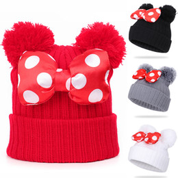 crochet baby skull caps NZ - 4 colors Baby Pom Pom beanie cap Toddler Kids Baby Girls Winter Warm Crochet knitted hat Bow Fur bow hat Wholesale AJY820