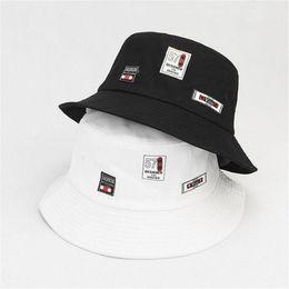 ebf46d8b2cc 2018 Cotton 57 Patch Bucket Hat Fisherman Hat Folding cap outdoor Sun Cap  Hats for Men and Women 45