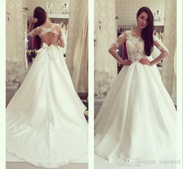 Wholesale aline skirts for sale - Group buy Lace Beach Sexy New Arrival Aline Wedding Dresses Jewel Illusion sleeve Appliques Criss Cross Empire Satin with Bow SweepTrain gown