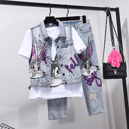 стиль точки джинсы оптовых-European Style Hole Jeans Set Womens Two Piece Sets Spring Summer Outfits New Vest Coat Seven Point Denim Pants Girls Students
