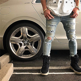 Stars Trousers NZ - Luxury Style Holes Jeans Destruction Chess Rivet Trousers Blue White Five-pointed Star Embroidery Spelling Cloth Jeans For Men HFWPKZ094