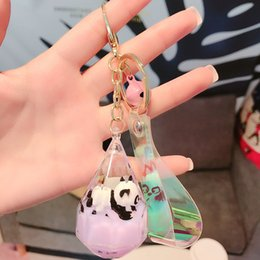 float keychain Canada - Creative Cute Floating panda acrylic milk bottle Keychain Moving Liquid quicksand drift bottle keyring for women bag pendant