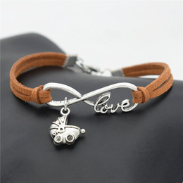 $enCountryForm.capitalKeyWord NZ - New Arrival Women Men Adjustable Jewelry Handmade Brown Leather Suede Infinity Love Babies Pram Buggy Lovely Baby Carriage Charm Bracelets