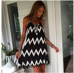 Wholesale European and American large size skirt female black and white wavy striped beach skirt fringed sling sexy chiffon long skirt