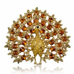 china clothes factory Australia - New Smoked yellow crystal peacock brooch animal clothing gift factory sales