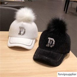 warm baseball cap NZ - 2019 hat women's fashion rhinestone D all-match fur ball baseball cap warm Leisure