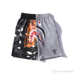 China Summer Men's Black Gray Splice Shark Pants Shorts Cotton Causal Shorts Men Casual Camouflage Skateboard Short Pants Loose Streetwear cheap legging camouflage print suppliers