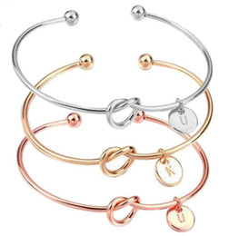 Discount unisex initial bracelets - 26 A-Z English Letter Initial Bracelet Silver Gold Letter Charm Bracelet Love Bowknot Wristband Cuffs Women Jewelry Will