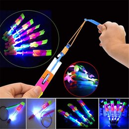 Rocket flying toy online shopping - Hot Amazing Flashing Led Arrow Rocket Helicopter Rotating Flying cs Light Up For Kids Party Decoration Gift