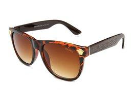 Venta al por mayor de 2019 Nuevo ojo de gato Mujer Gafas de sol Tintado Lente de color Hombres Gafas de sol con forma vintage Gafas de sol azules Diseñador de la marca