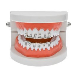 dental alloys NZ - Wholesale Hip Hop Mens Teeth Grillz Dental Grills Volcanic Lava Suit Dental Grills Unique Shape Teeth Grillz Luxury Jewelry Free Shipping