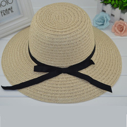 ladies beach hats NZ - Summer Women Straw Hats Outdoor Sun Protection Foldable Hat Bow Ribbon Along the Beach Caps Ladies Wide Brim Straw Hats