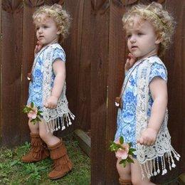 Großhandel Neue baby kleinkind kind baby häkelspitze aushöhlen fransen quasten ärmelloses hemd top weste quaste weste