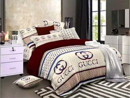 Wholesale Hot sleek minimalist bedding set of four aloe vera cotton chemical fiber comfortable letter printing bedding four sets
