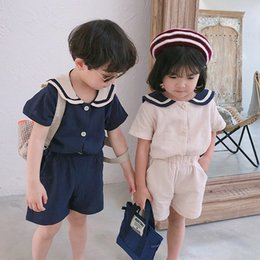 korean kid cute t shirt UK - 2019 Summer Korean style kids sailor collar cotton linen clothes sets cute boys girls short sleeve T shirt + shorts 2pcs suits CY200515