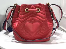 Heart Shaped Bags Australia - famous women barrel-shaped bags cowhide leather hearts strings size 22*21*11cm
