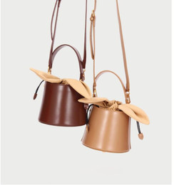 Wholesale Design lady bag bucket lady bag new bow knot one shoulder slanting handbag bags leathers