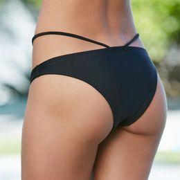 be25158ab099 Solid Color Sexy Bandage Bikini Bottom Women Beach Wear Thong Low Waist  Bikini Bottom Brazilian Biquini Bathing Suits Swimsuit