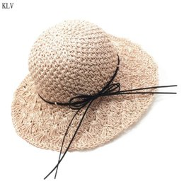 girls pink straw sun hats NZ - Women Girls Handmade Crochet Weave Foldable Beach Straw Sun Hat Floppy Wide Brim Bowknot Lacing UV Protection Summer Bucket Cap