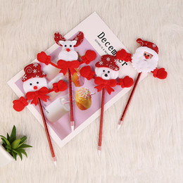 Discount santa pens - 2019 NEW Plush Christmas Ball Pens Snowman Elk Santa Ballpoint Pen Xmas Ornament Gift Cartoon Korea Student Stationery N