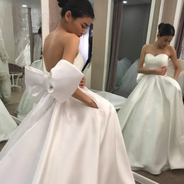 custom bridal robes NZ - Simple Ball Gown Wedding Dresses Sweetheart Sexy Back Open Custom Made Ivory Romantic Puffy Bridal Gowns with Back Big Bow robe mariee