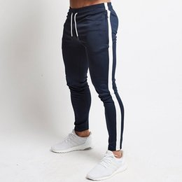 skinny tracks NZ - Mens Joggers Casual Pants Fitness Men Sportswear Tracksuit Bottoms Skinny Sweatpants Trousers Black Gyms Jogger Track Pants T200324
