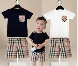 cfc662d1bb3f4 vetements pour enfants garçons et filles loisirs costume de sport t-shirt  poche + shorts à carreaux