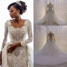 sleeved wedding dress plus Canada - Luxury Crystal Beaded Long Sleeved Dubai Arabic Mermaid Wedding Dresses With Detachable Train Sexy Real Pictures Plus Size Bridal Gown