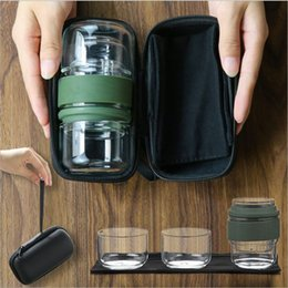 tea set two NZ - transparent blowing Glass travel tea set portable bag crack carry a pot two cups kung fu tea art cup elegant cup bubble teapot