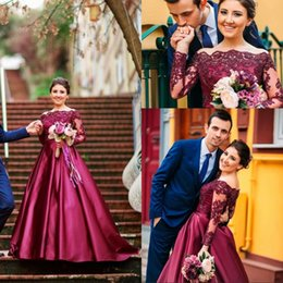 $enCountryForm.capitalKeyWord Australia - Sping 2019 Gorgeous Arabic Evening Prom Dresses Beaded Lace Appliqued Bodice Sheer Long Sleeves A Line Fuchsia Satin Formal Evening Gowns