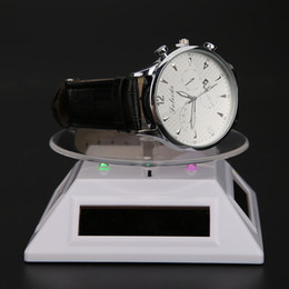 Rings Showcase Australia - Fashion 3LED Color Lights Solar Showcase 360 Degree Turntable Rotating Jewelry Watch Ring Display Stand Creative Jewelry Display