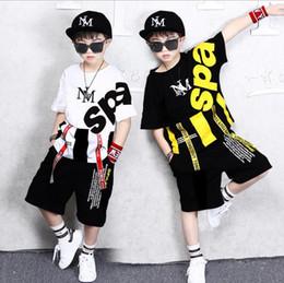 $enCountryForm.capitalKeyWord Australia - Novelty personality children's suit big boy short-sleeved T-shirt + shorts two-piece children's performance clothing 4-12 years