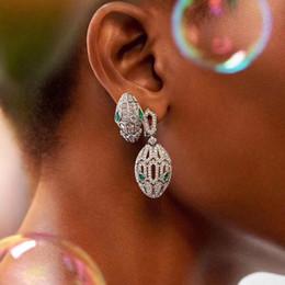 European and American fashion green eye snake head earrings silver needle female full diamond zircon personality snake earrings short hollow on Sale