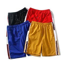 Venta al por mayor de Diseñador para hombre Pantalones cortos de verano Pantalones Moda 4 colores letra impresa pantalones cortos con cordón 2019 relajado Homme lujo pantalones de chándal