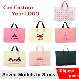 Wholesale Clothes Shopping Australia - Wholesale 100pcs lot High quality plastic shopping Bags with handle clothes gift packaging bags in stock also can custom