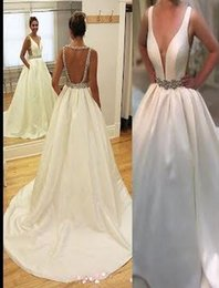 Black Crystal Price Australia - Big Discount A Line V Neck White Taffeta Backless Crystal Wedding Dresses Chapel Train Sleeveless Low Price Bridal Gowns