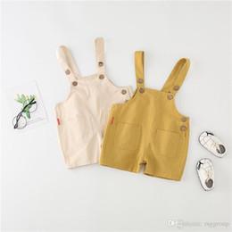 $enCountryForm.capitalKeyWord Australia - INS Toddler Kids Boys Jumpsuits Overalls Blank Blet Rompers Front Wood Buttons Pocket Designs Summer Spring Children Girls Suspender