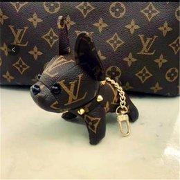 Ingrosso Creativo cane in pelle metodo di combattimento appeso bambola vecchia chiave fiore sacchetto accessori coppia catena regalo marea NO BOX