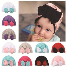 Fallen Hats Australia - 2019 New Baby fall winter hats Wholesale Contrast Bow beanie bonnet girls muslim turban skull cap accessories