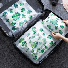 designer luggage bags Canada - 5pcs Flamingo Travel Storage Bag Transparent Cosmetic Bag Wardrobe Suitcase Pouch Plastic Luggage Organizer Clothes Shoes