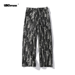Wholesale hip hop trousers zips resale online – LMCAVASUN Hip hop street ripped jeans trousers Distressed washed loose wild straight jeans men Men s straight zip trousers