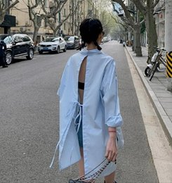white backless blouse 2020 - 2020 autumn girl's fashion design feeling Backless long shirts female sexy Single-breasted long sleeves Solid color