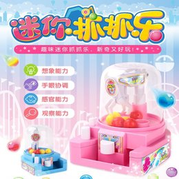 inflatable candy Canada - Inflatable Bounce House Le Ji Er H22A Childrens Small Doll Holder Toy Clip Candy Holder Mini Capture Machine Egg Twisting Machine