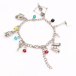 charms axe NZ - The inspired bracelet Apocalypse Zombie Survival Horror charm cross bow axe gun pendant bracelets for Women men